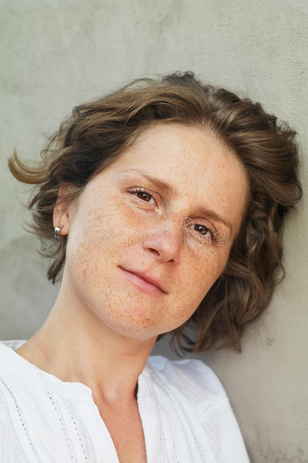 Woman with freckles portrait stock photo