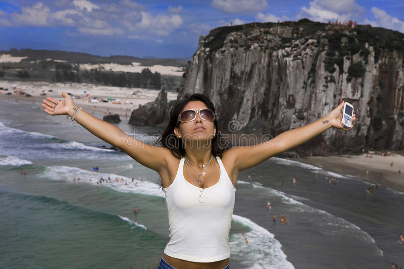 Woman free with mobile phone royalty free stock photography