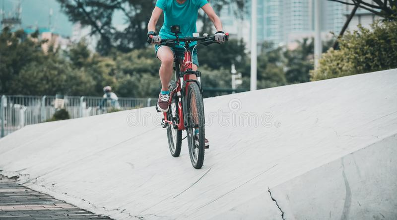 Woman freerider riding down ramps. Sports extreme and active lifestyle royalty free stock images