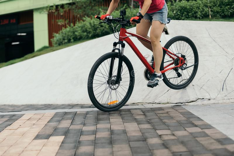 Woman freerider riding down ramps. Sports extreme and active lifestyle stock photography