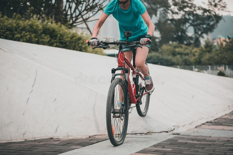 Woman freerider riding down ramps. Sports extreme and active lifestyle stock photo