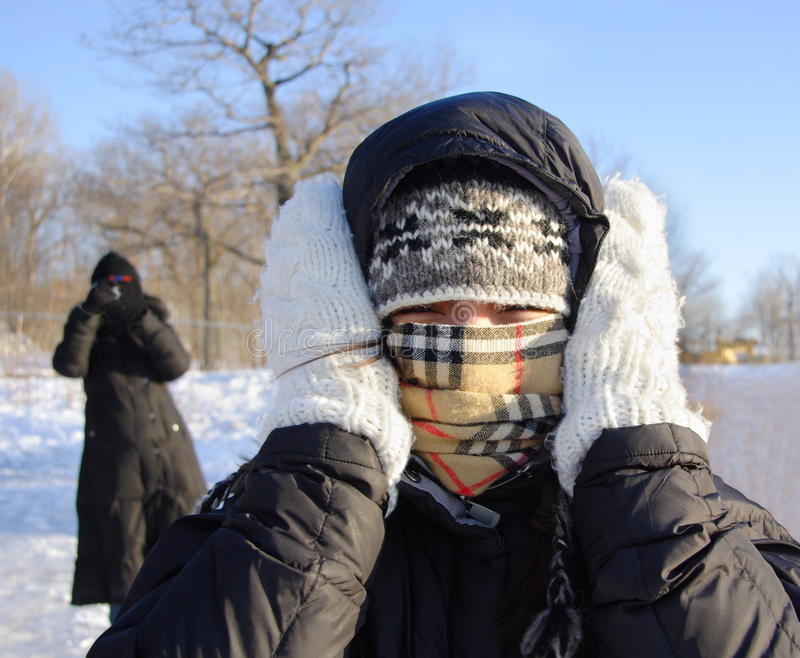 Woman freezing cold. Cold winter woman covering herself from the cold royalty free stock photos