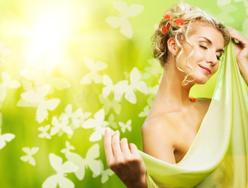 Woman with fresh flowers in her hair. Beautiful young woman with fresh flowers in her hair. Spring concept royalty free stock photos