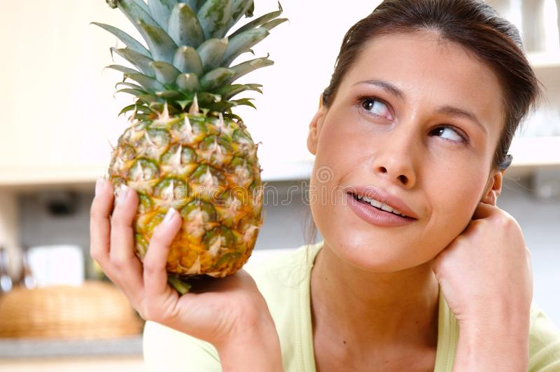 Woman with fresh pineapple. Young woman with fresh pineapple stock photography
