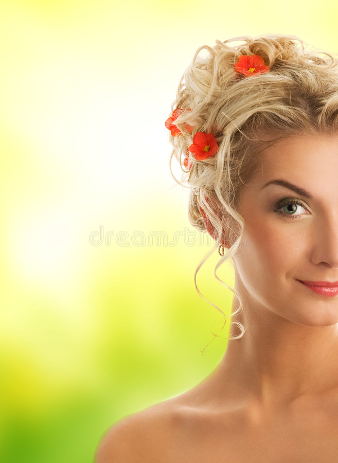 Woman with fresh spring flowers. Beautiful young woman with fresh spring flowers in her hair royalty free stock photo