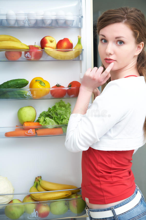 Woman and fridge stock image