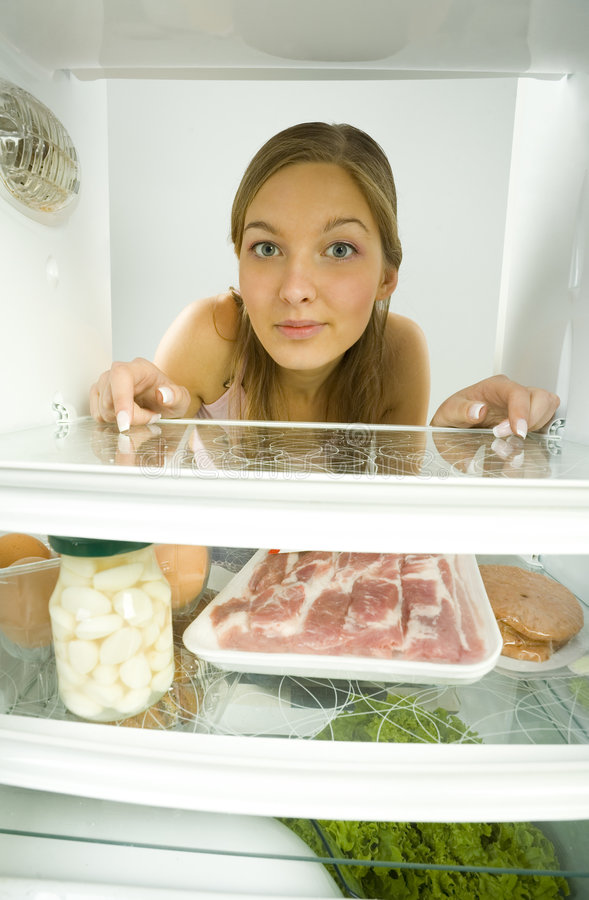 Woman in fridge stock photos