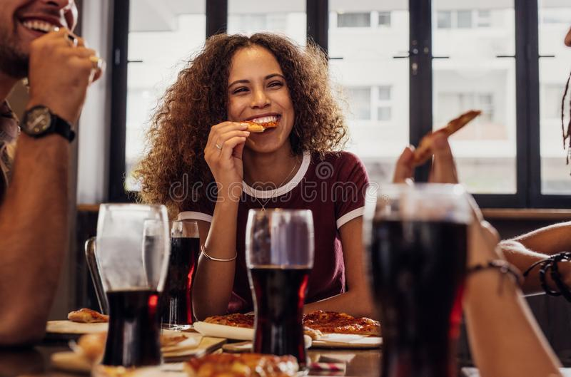 Woman with friends enjoying a meal stock photo