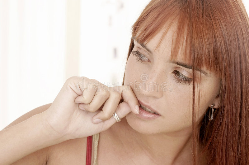 Woman With  A Fringe Biting Her Nails Stock Image