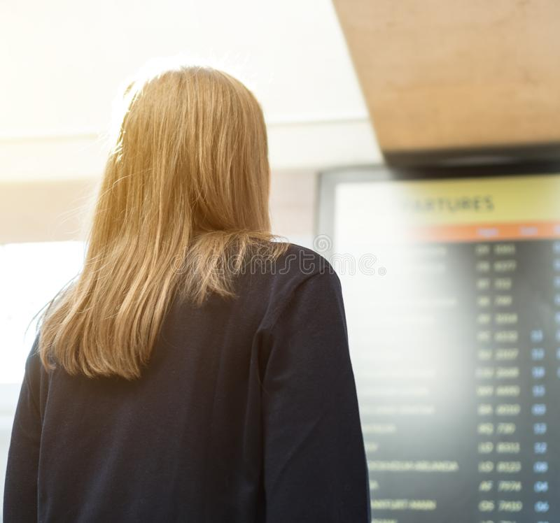 Woman checking her flight. stock photos