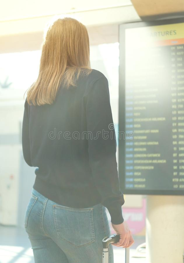 Woman checking her flight. stock photography