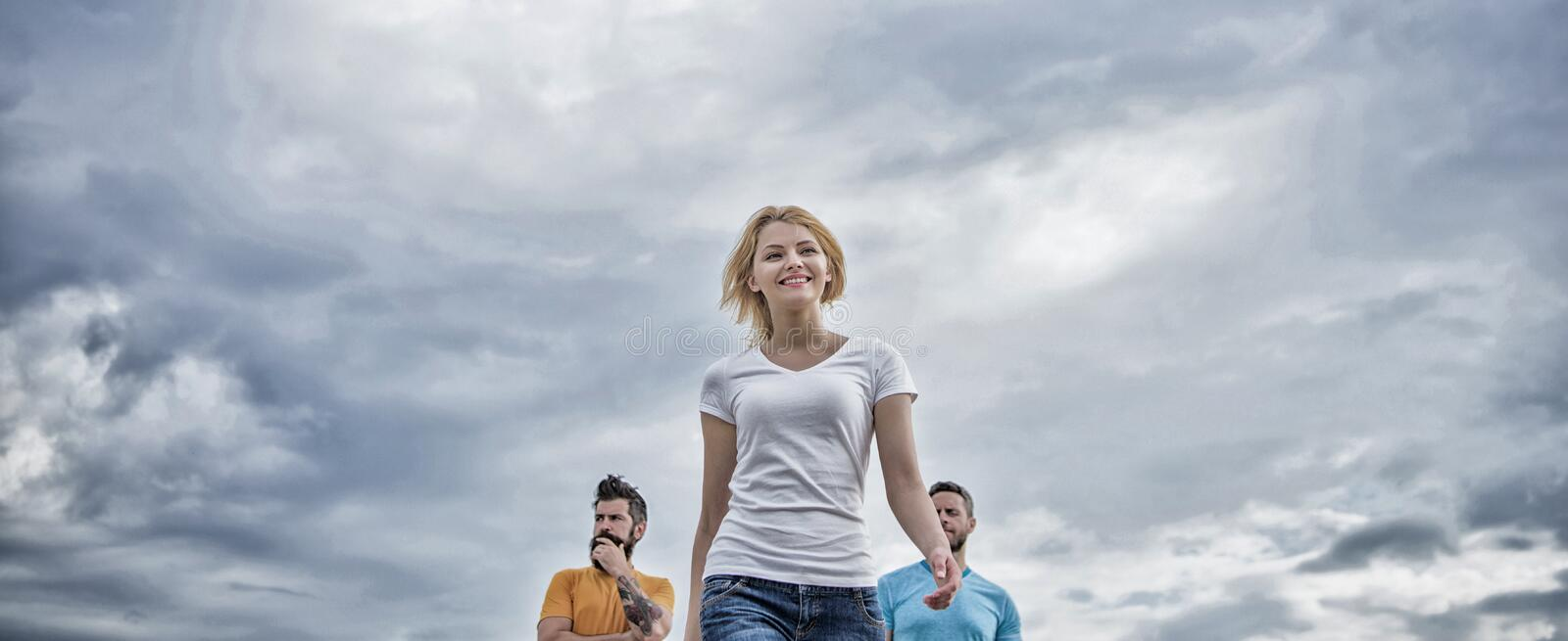 Woman in front of men feel confident. Moving forward support male team. What makes successful female leader. Girl leader. Qualities possess naturally stock photos