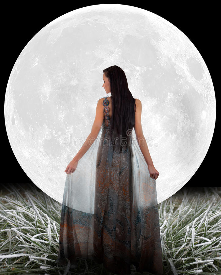 Woman in front of a Moon. stock images