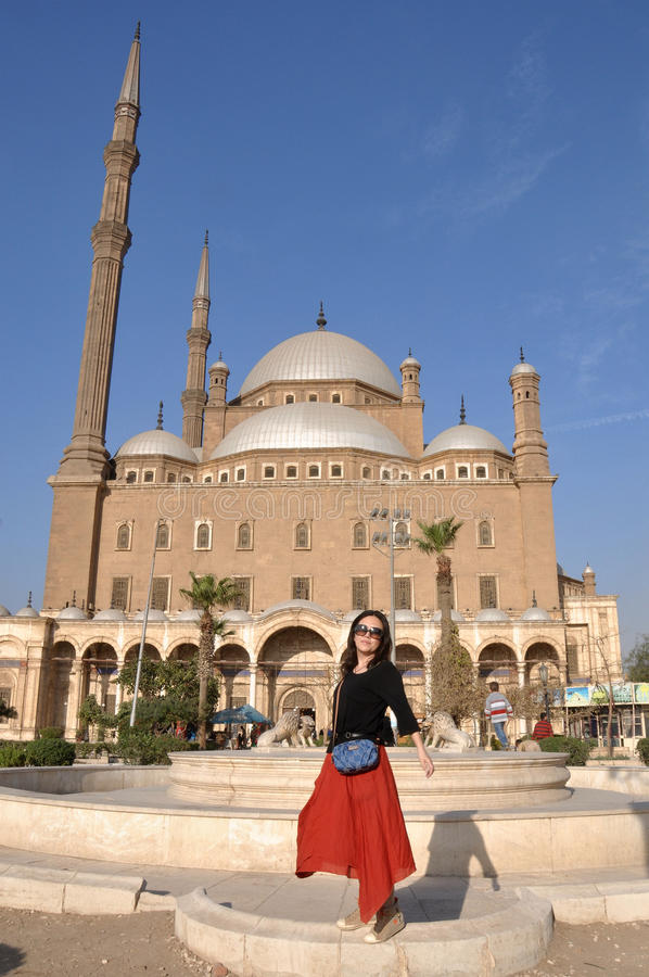 WOMAN IN FRONT OF MOSQUE,Egypt stock image