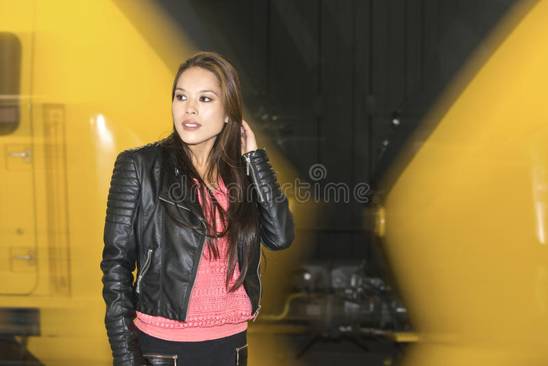 Woman in front of a passing train royalty free stock photography