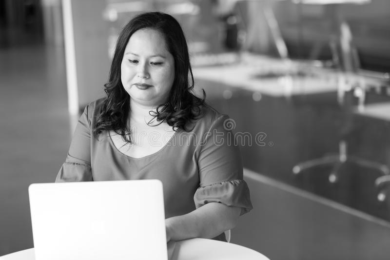 Woman in Front of Table Looking at Laptop royalty free stock photography