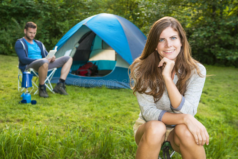 Woman in front of tent stock images