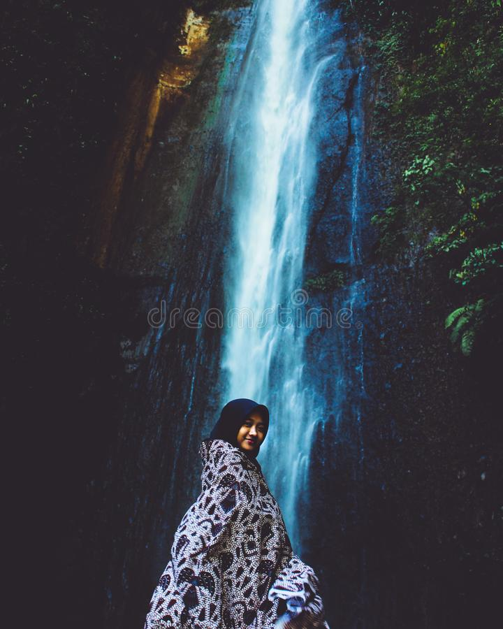 Woman in Front Waterfall royalty free stock images