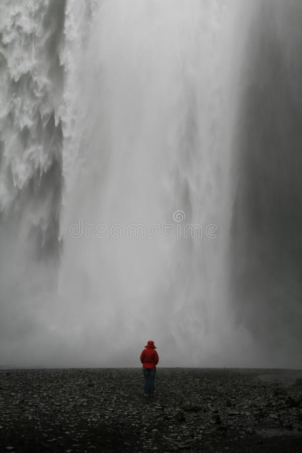 Woman in front of waterfall stock photo