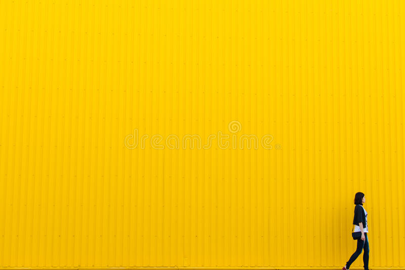 Woman In Front Of Yellow Wall Free Public Domain Cc0 Image