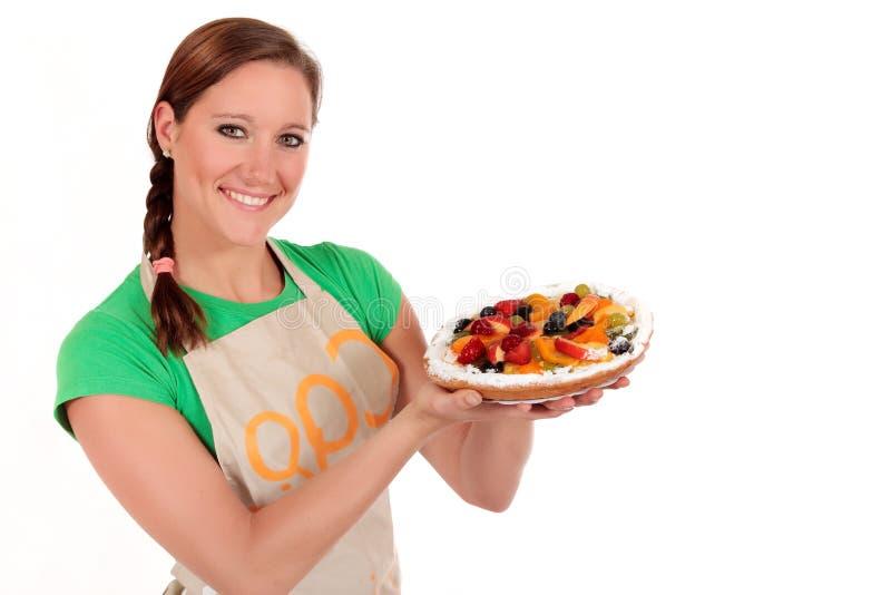 Woman fruit pie royalty free stock image