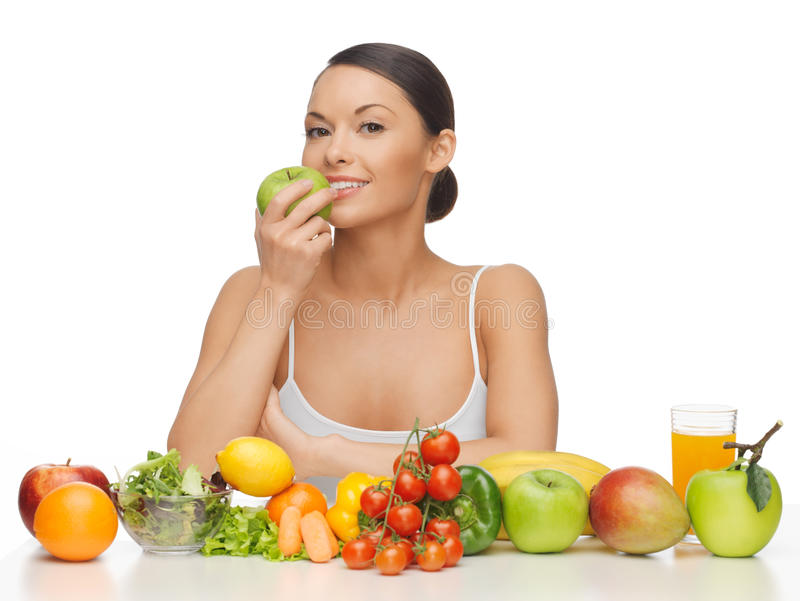 Woman with fruits and vegetables stock photography