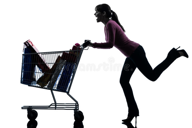 Woman with full shopping cart silhouette. One caucasian woman with full shopping cart in silhouette studio on white background royalty free stock photography