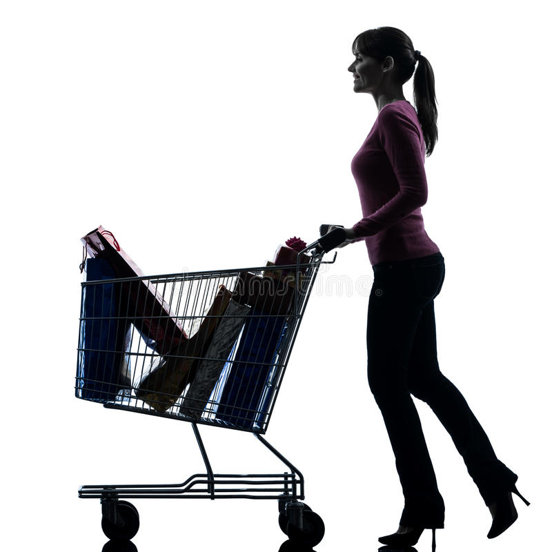 Woman with full shopping cart silhouette royalty free stock photo