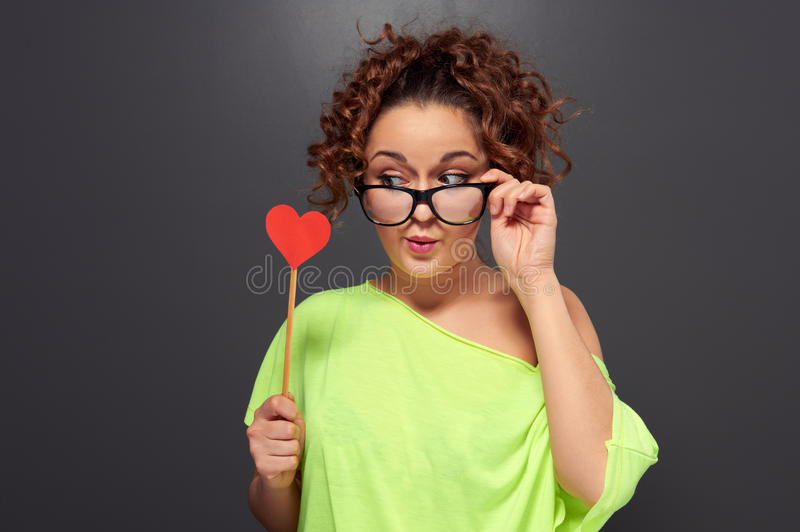 Woman In Funny Glasses Looking At Red Heart Royalty Free Stock Image
