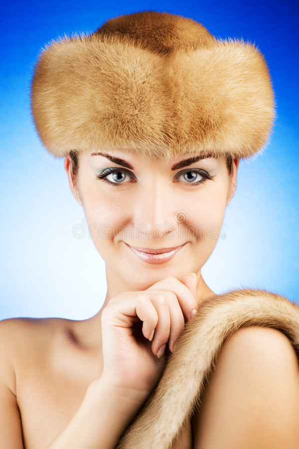 Woman in fur cap. Beautiful young woman in fur cap stock image