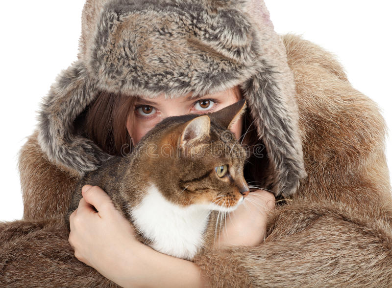 Woman in a fur coat and hat with cat