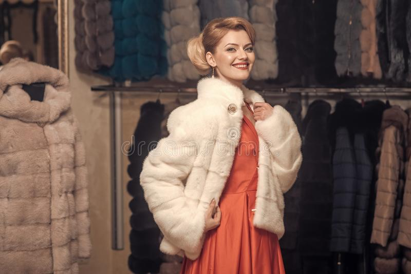 Woman in fur coat, shopaholic. stock photography