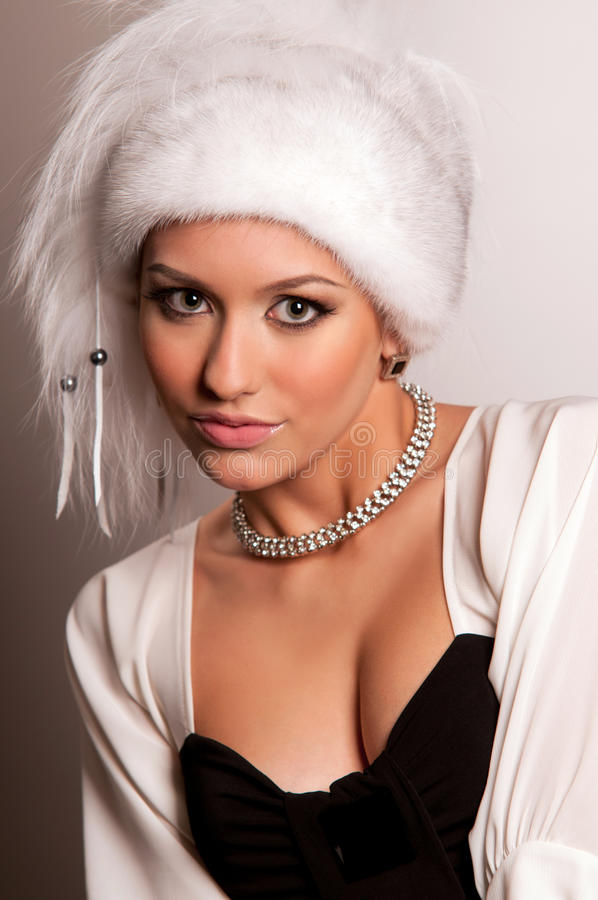 Download Woman in a fur hat stock image. Image of make, person - 20560845