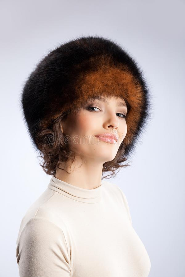 Download Woman In A Fur Hat stock photo. Image of care, brunette - 9850202