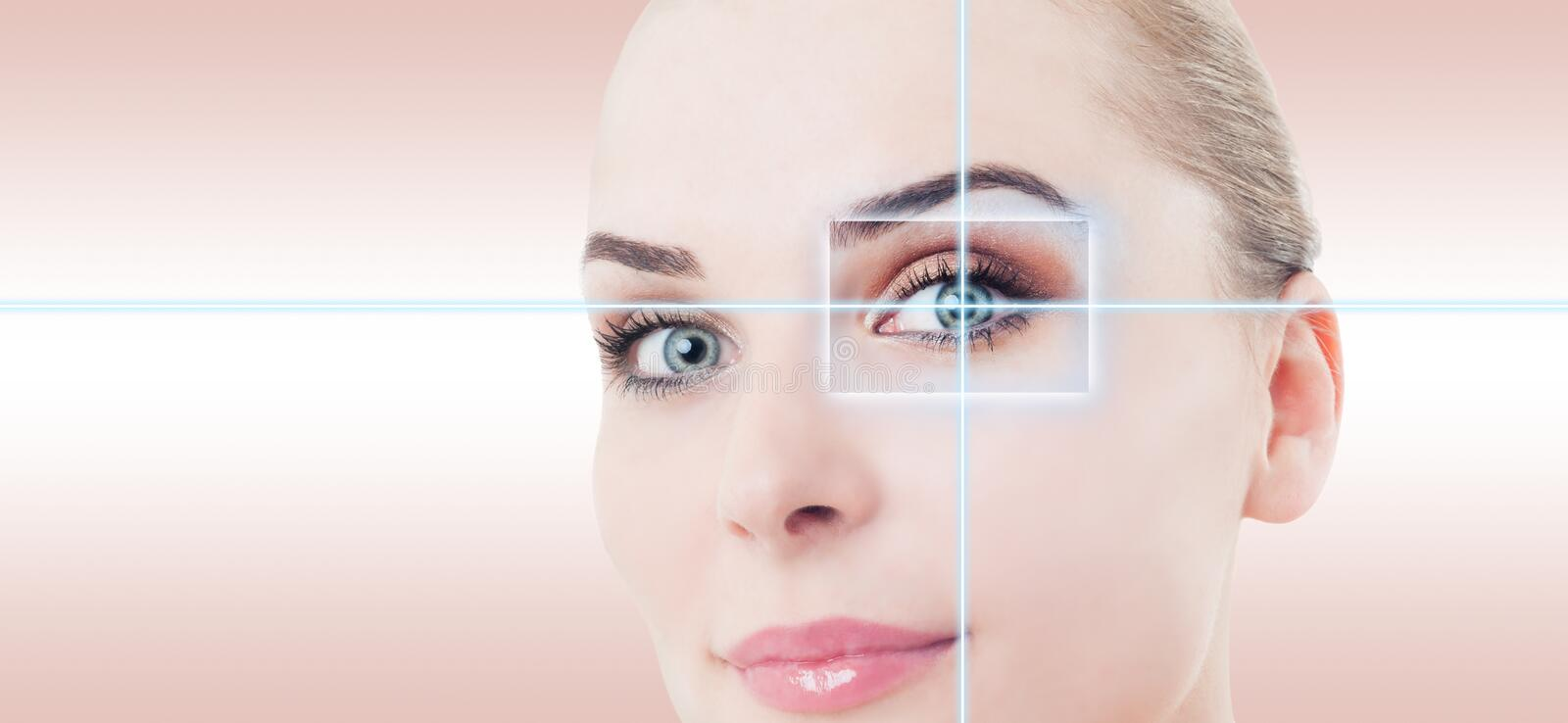 Woman futuristic eye with laser high-tech identification. As medicine and vision concept against pink or purple background stock photos