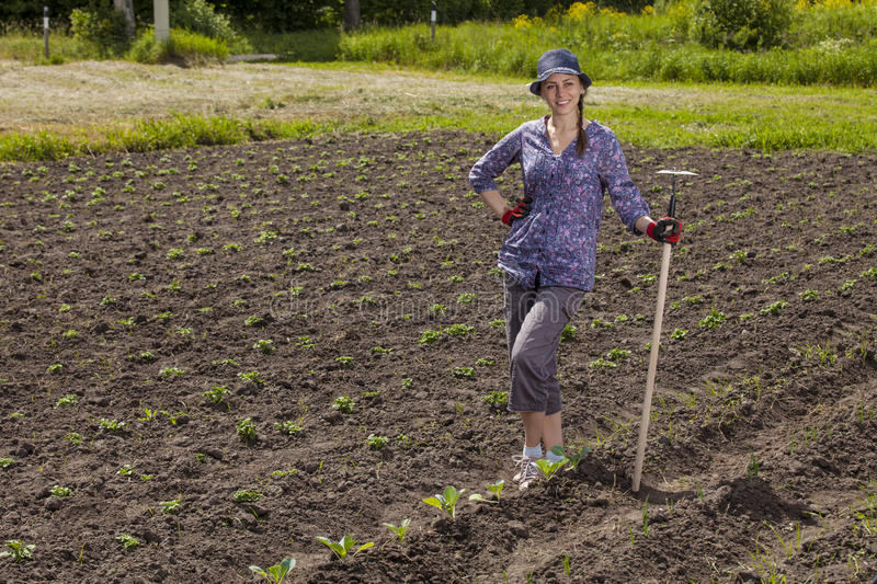 Woman at garden royalty free stock photography