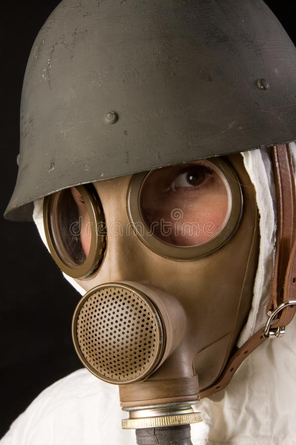 Woman in gas mask and helmet stock photos