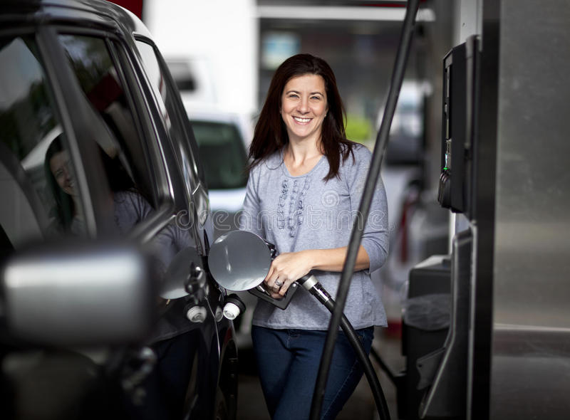 Woman at gas station stock photos
