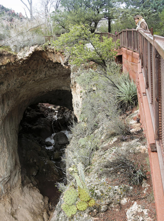 A Woman Gazes Down from the Tonto Natural Bridge Viewpoint 4 stock photo