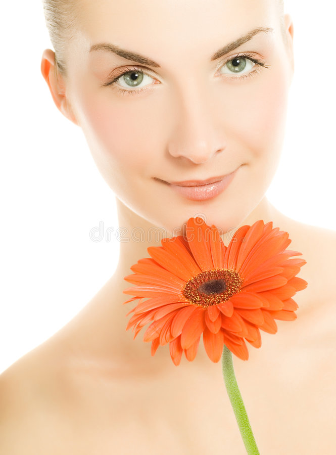 Woman with gerber flower. Beautiful young woman with gerber flower isolated on white background royalty free stock image