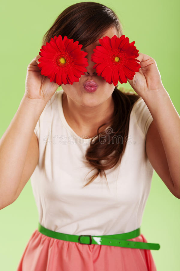Woman With Gerbera Stock Images