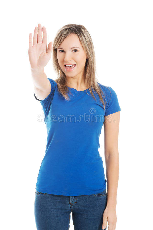 Woman gesturing stop sign stock image