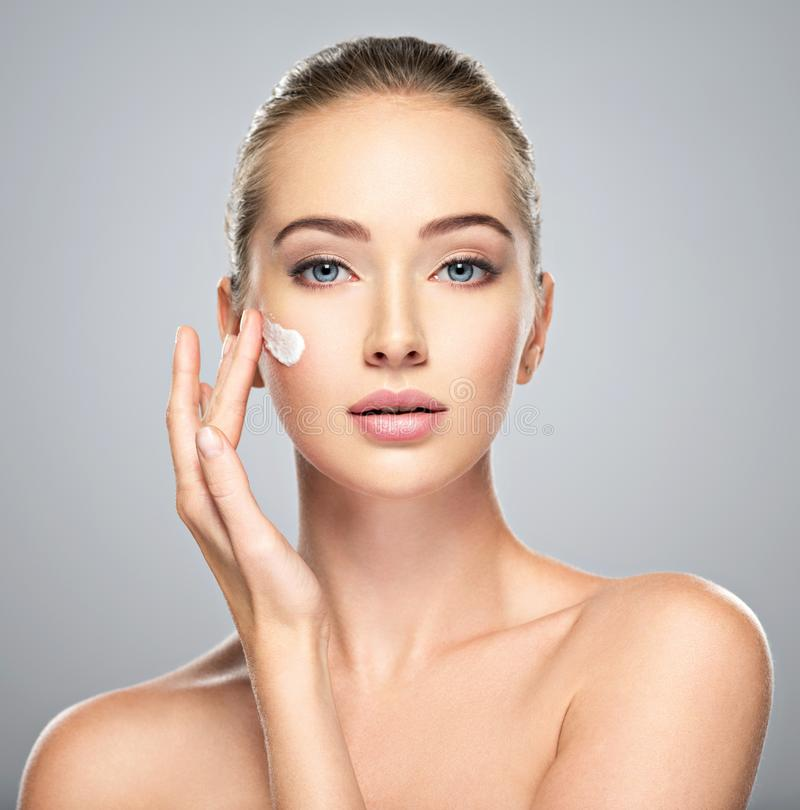 Free Woman Gets Cream In The Face. Skin Care Concept. Royalty Free Stock Photography - 102301777