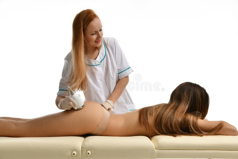 Woman getting anti cellulite and anti fat therapy on her tight buttocks in beauty salon. Body care. Ultrasound cavitation body. Contouring treatment. Spa and stock photo
