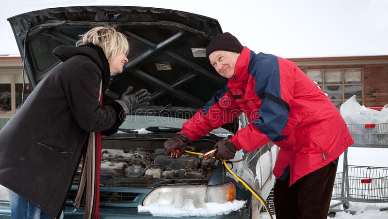 Woman getting a boost (Old car version) stock photos