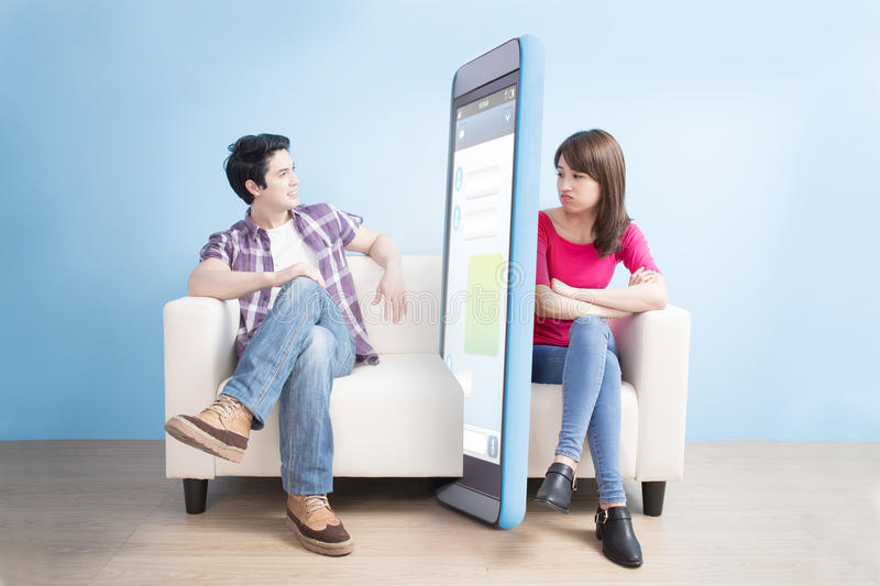 Woman is getting bored. While men is playing smart phone stock photos