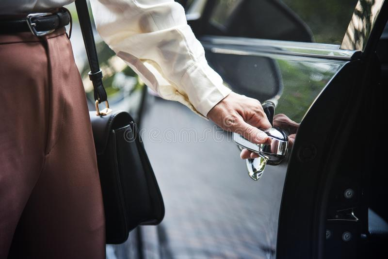 Woman getting into a car royalty free stock photography