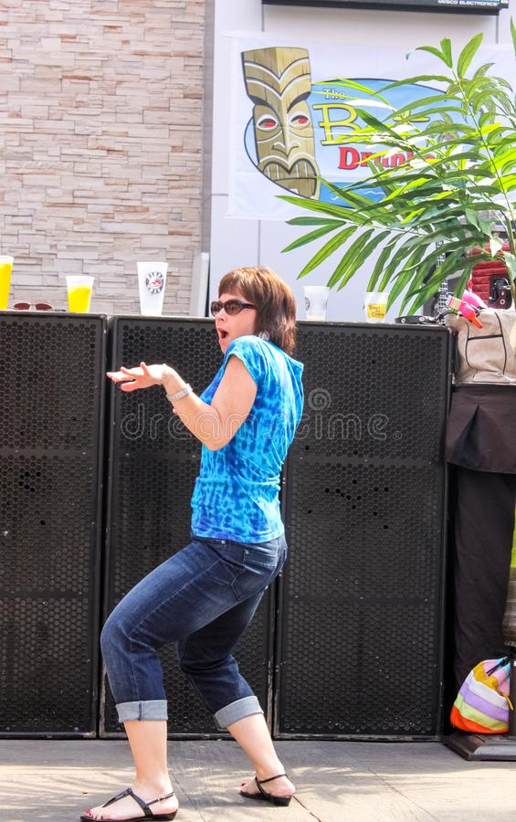 A Woman Getting Into Dancing In Front Of Speakers At Pre Concert Jimmy  Buffet Party At Power And Light District In Kansas City MO May 5 2011