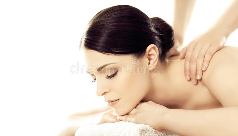 Portrait of a girl in spa. Massaging therapy procedure. Skin care and massage concept. stock images