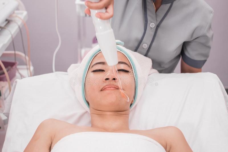 Woman getting facial darsonval therapy royalty free stock images